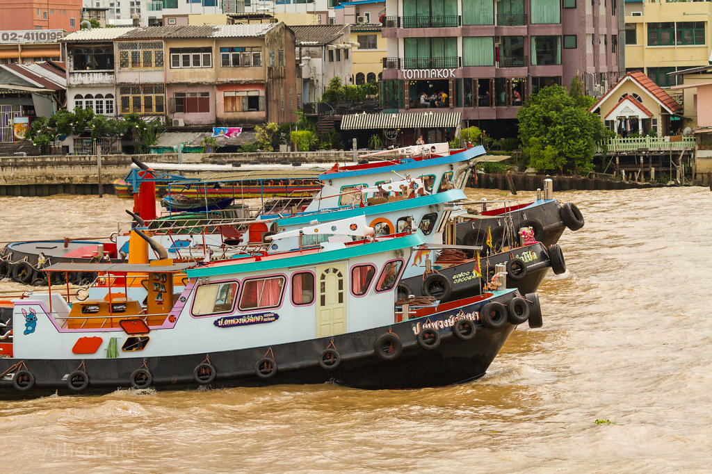 Tugs on the Chao Phraya pulling a huge barge train
